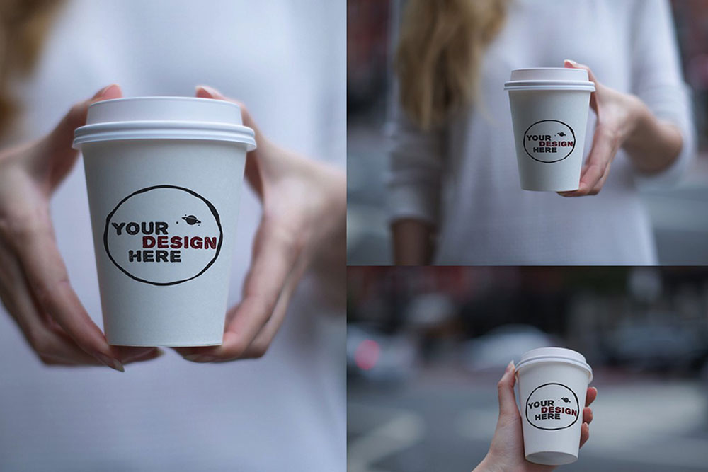 coffee cup in hand mockup