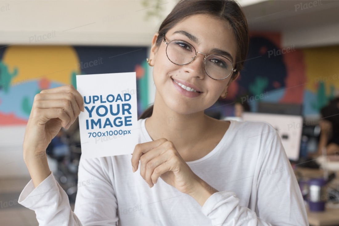 a6 flyer mockup featuring a smiling glasses-wearing woman