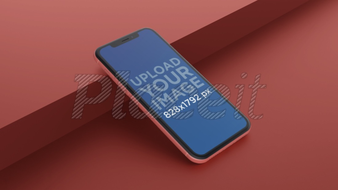angled coral iphone xr mockup lying against a step