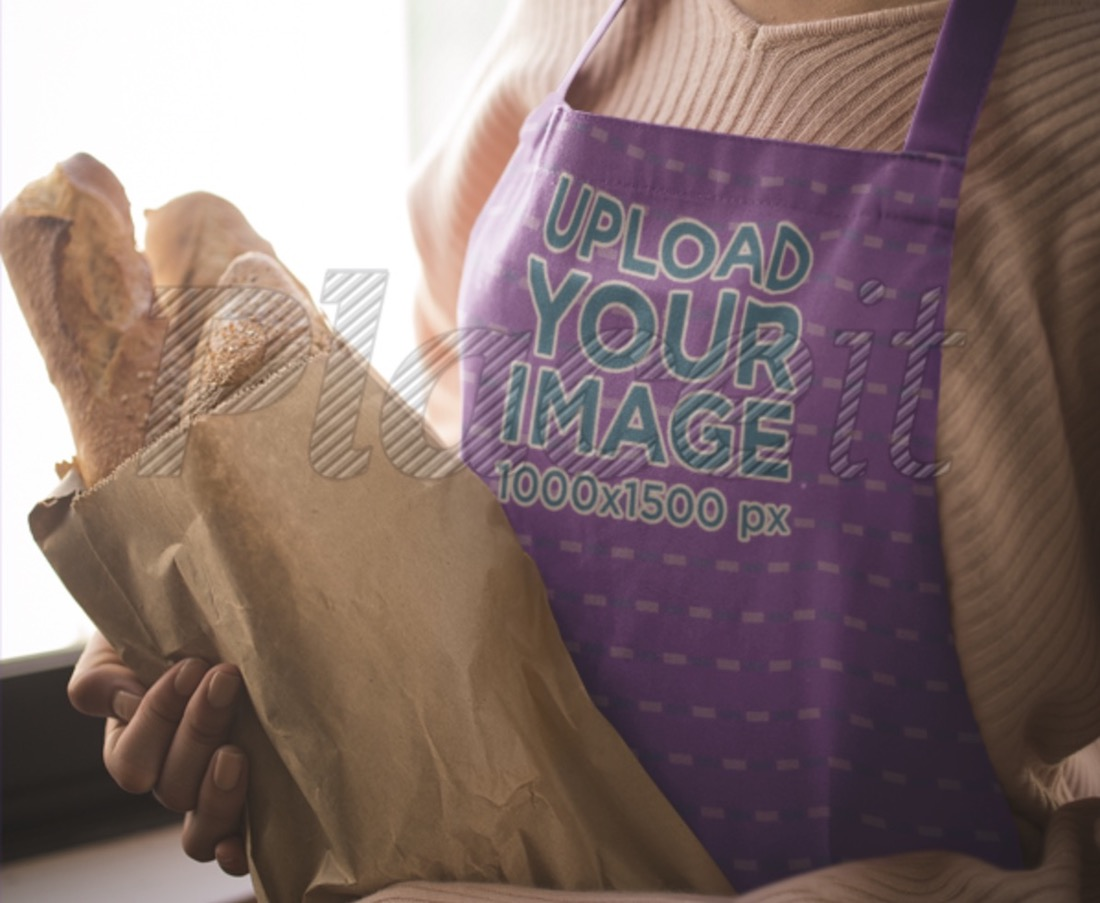 apron mockup featuring a girl holding a bag of bread