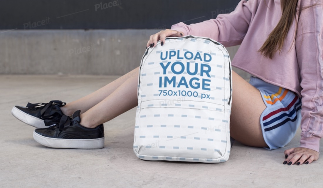 backpack mockup featuring a teen sitting on a street