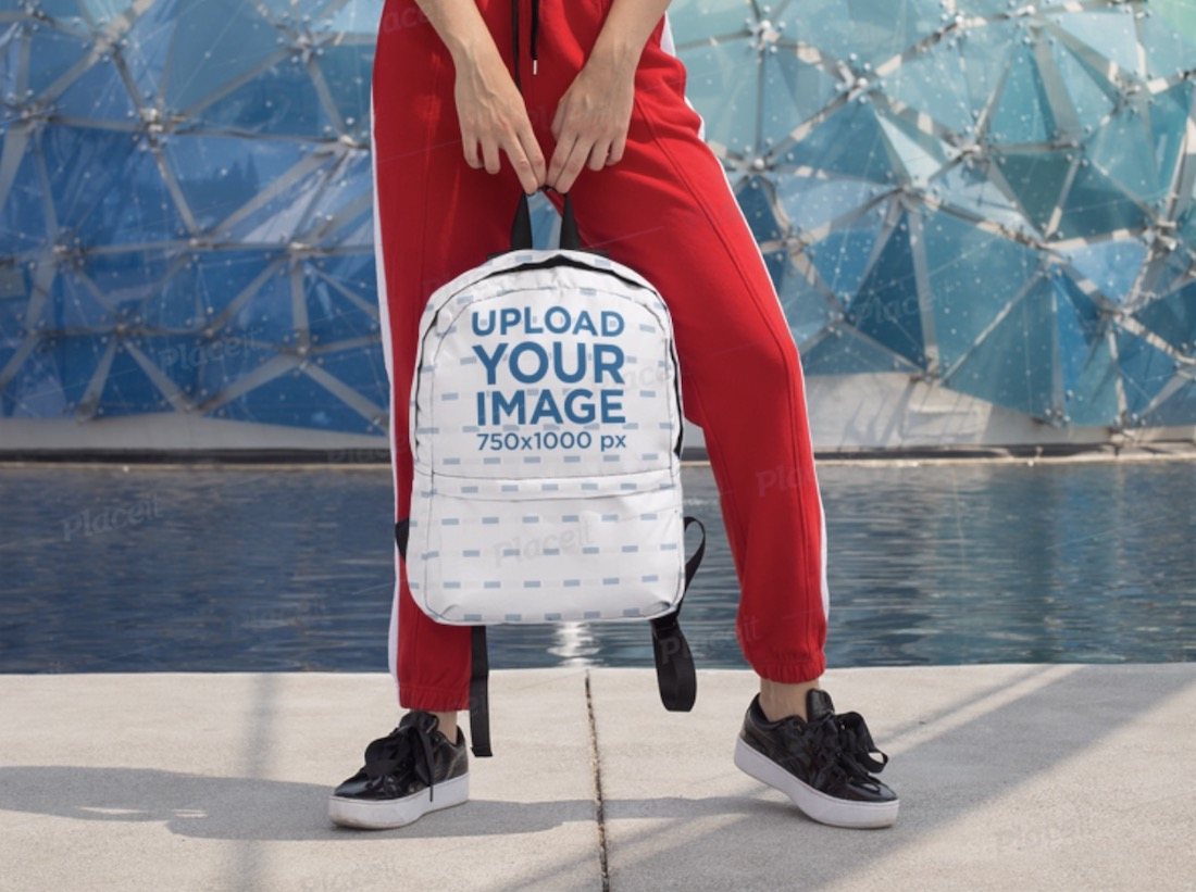 backpack mockup featuring a woman in jogging pants