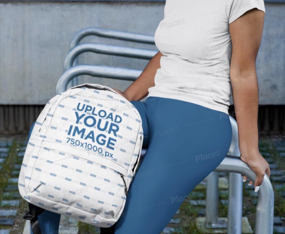 backpack mockup featuring a woman in sportswear