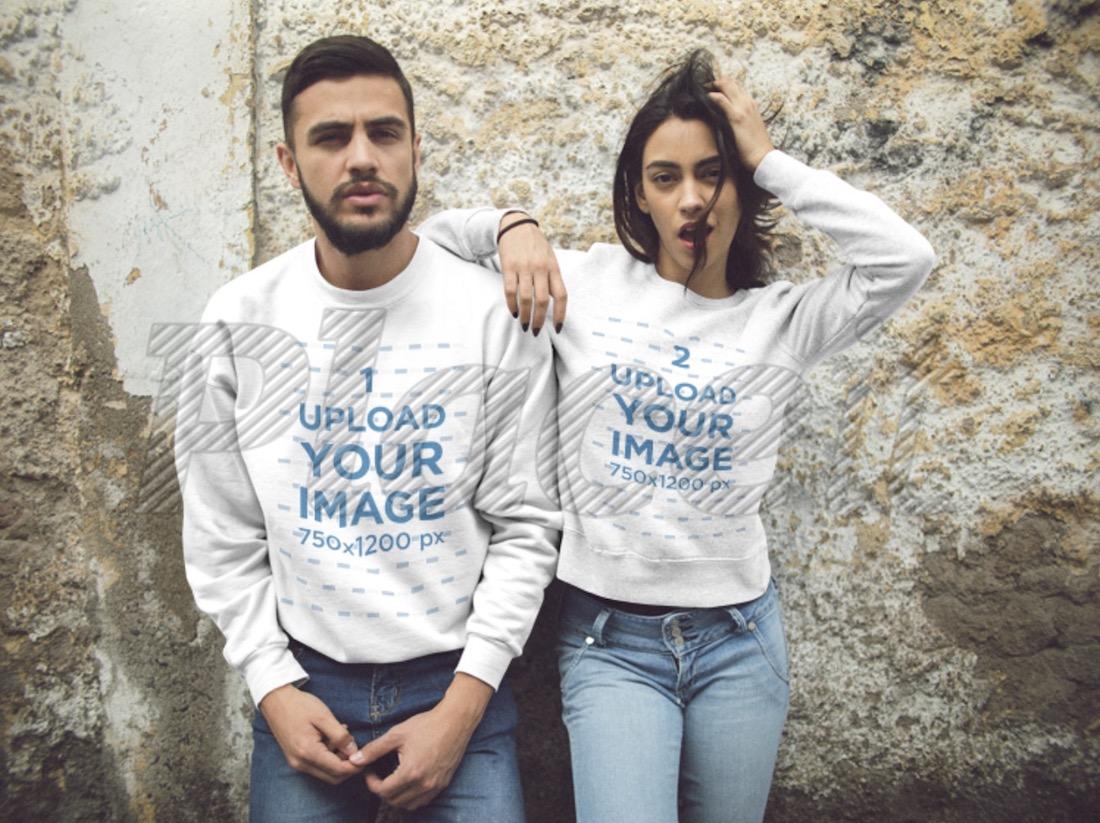 beautiful couple wearing crewneck sweatshirts