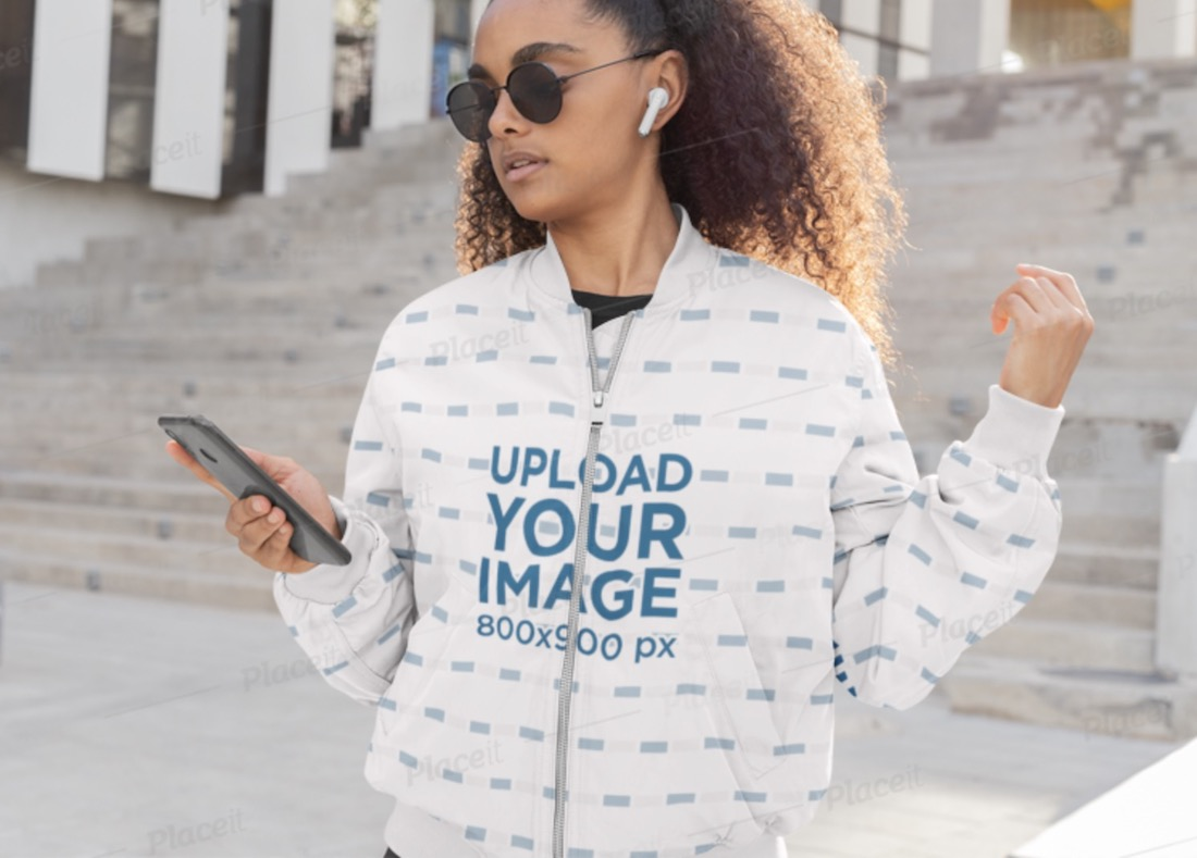 bomber jacket mockup featuring a woman listening to music