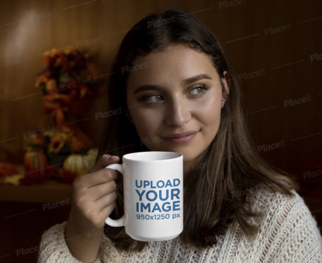 coffee cup mockup in hand featuring a woman in a knitted sweater