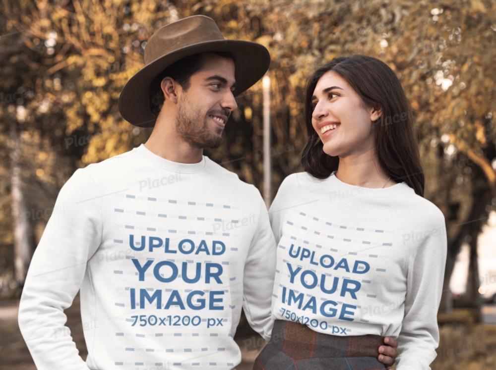 crewneck sweatshirt mockup of a couple posing at a park during autumn