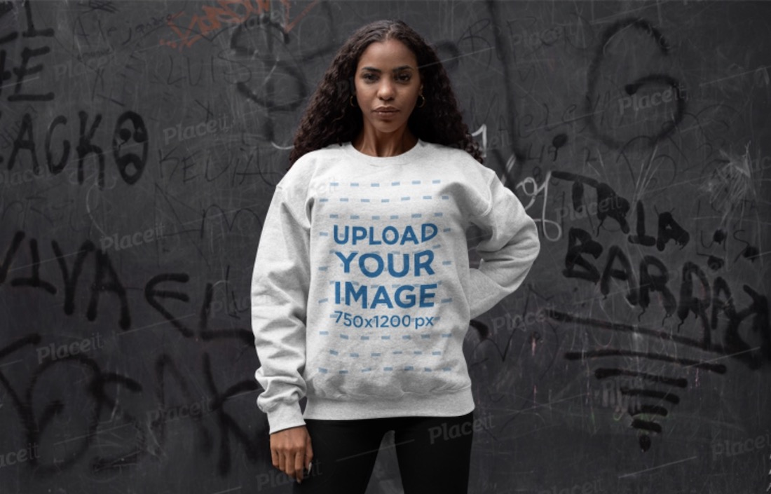 crewneck sweatshirt mockup of a woman posing against a graffiti wall