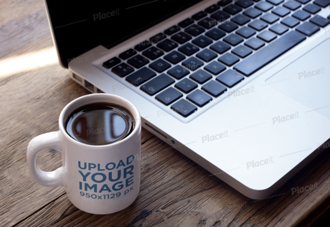 cup of coffee mockup near a macbook