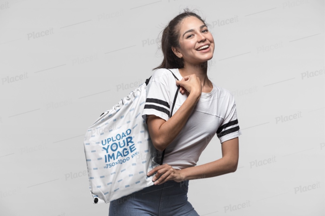 drawstring bag mockup of a woman smiling