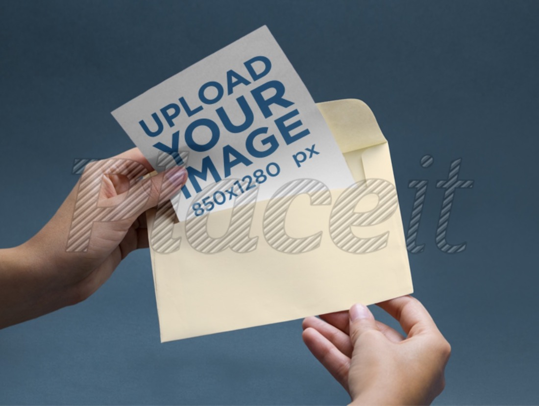 envelope mockup featuring a person picking the greeting card