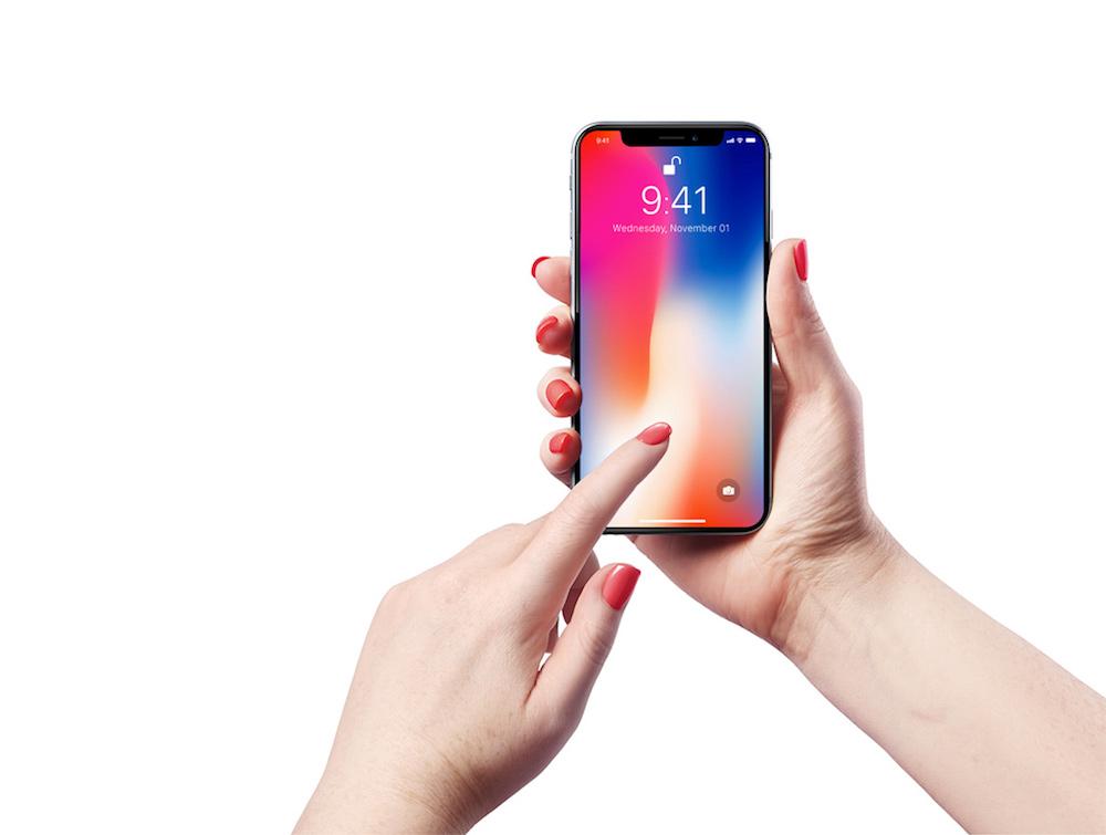 free iphone x in female hand mockup