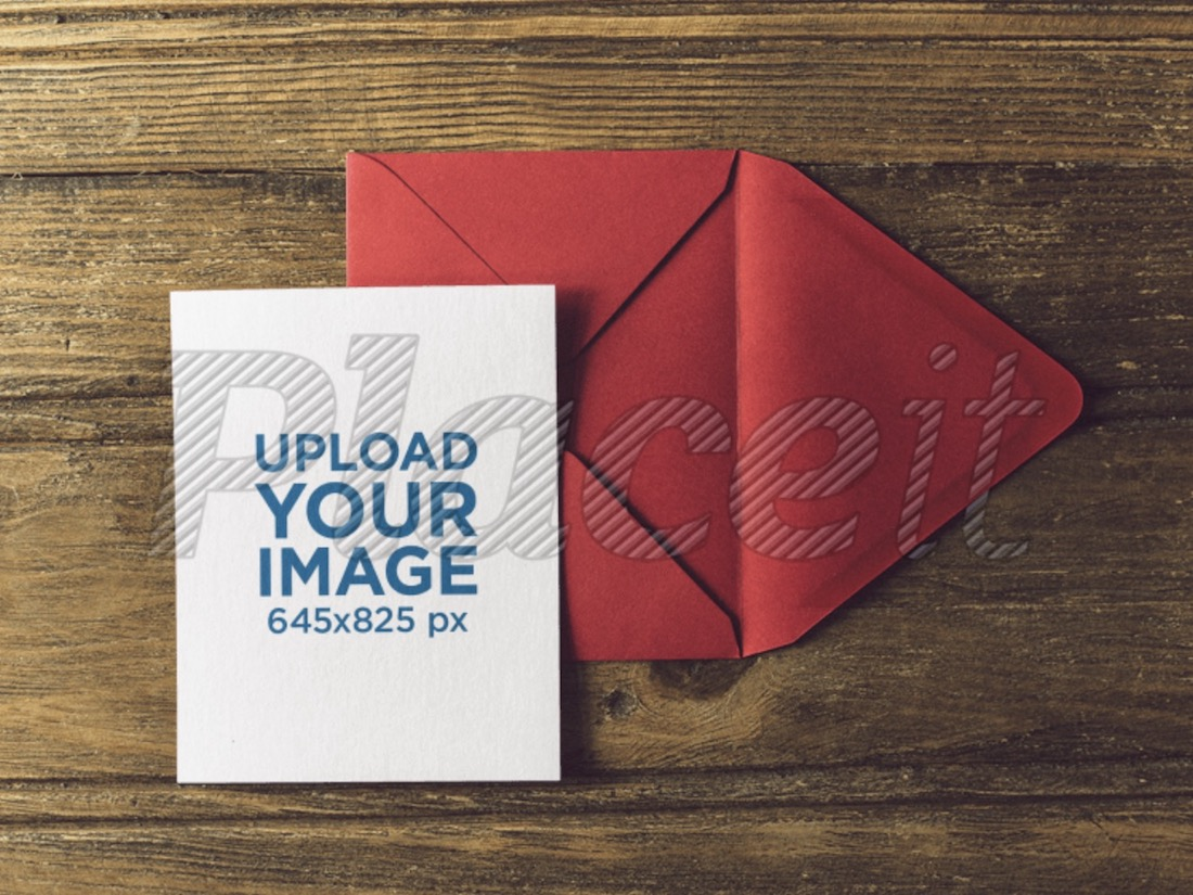 greeting card on a red envelope over a wooden table