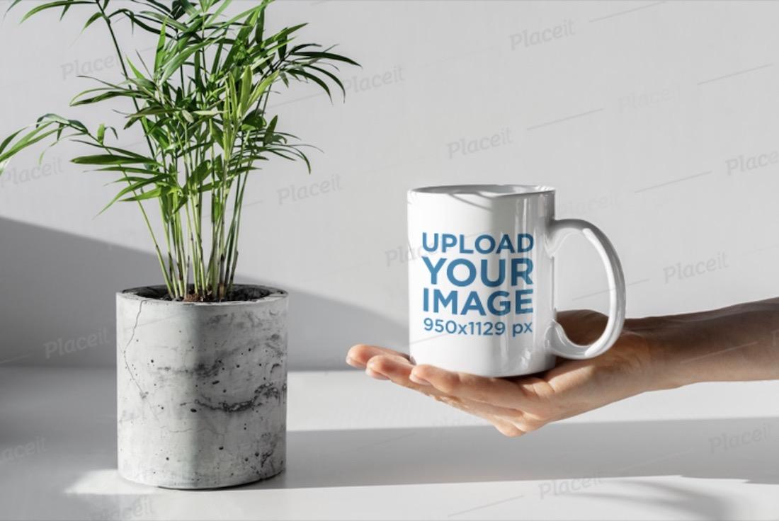hand holding a mug mockup