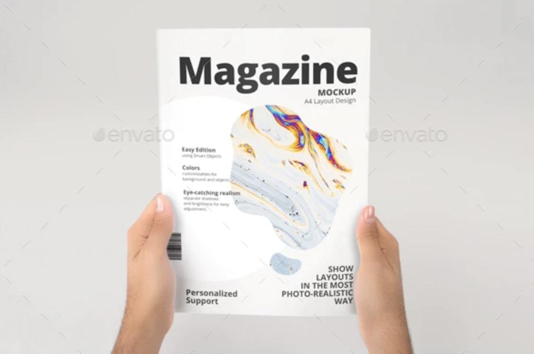 hand holding a4 magazine mockup