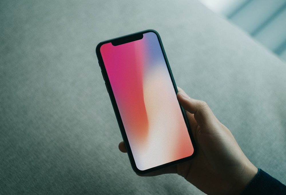 hand holding iphone x psd mockup