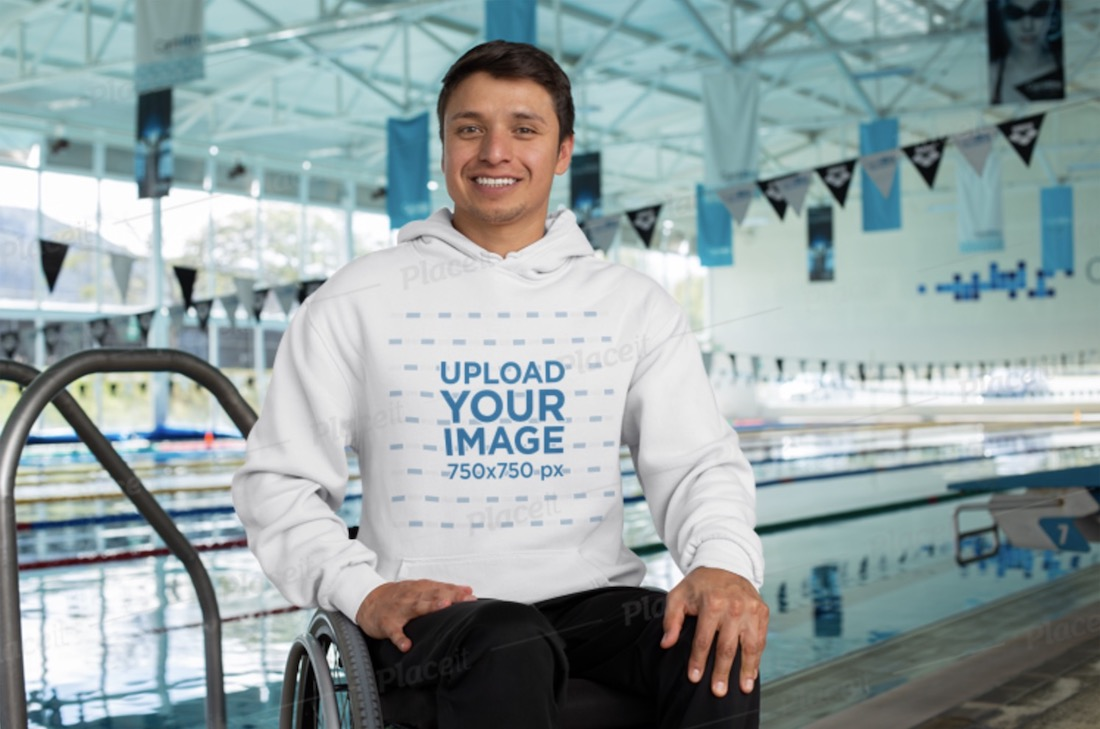 hoodie mockup featuring a man at a public pool