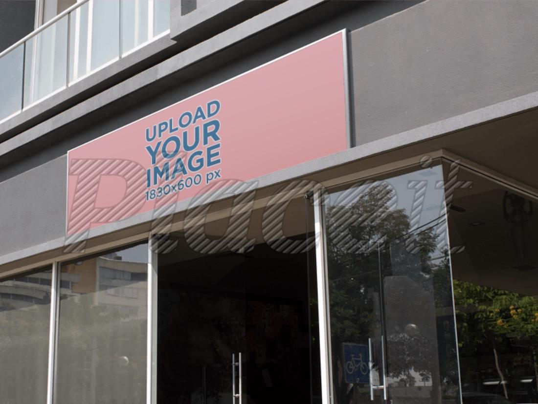 horizontal banner mockup at an office entrance