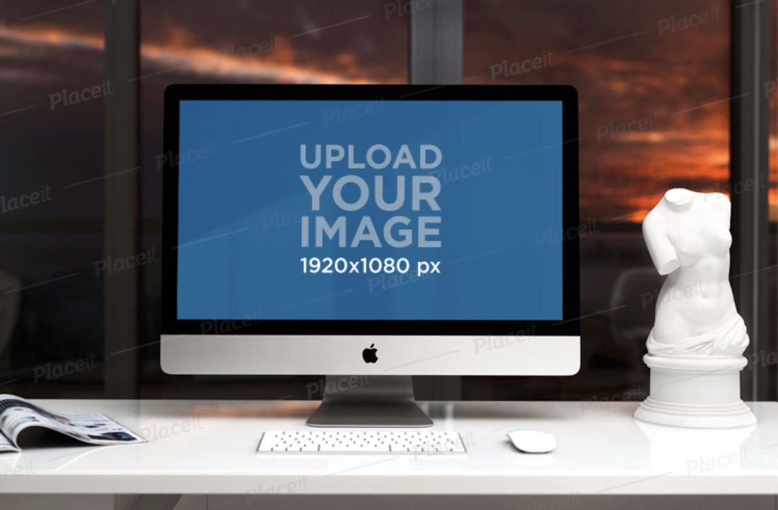 imac mockup featuring a white office desk and a sculpture