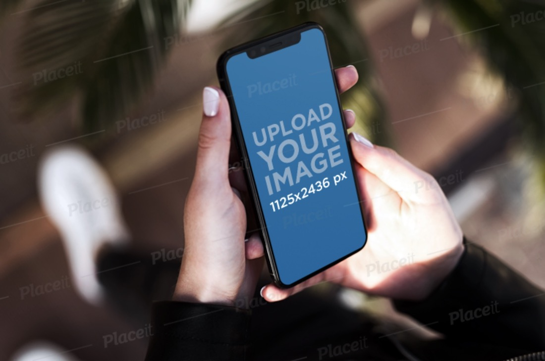 iphone 11 pro in woman's hands mockup