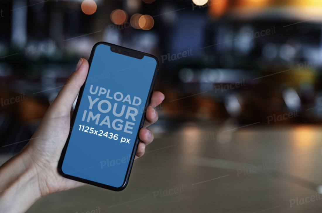 iphone 11 pro mockup featuring blurred lights in the background