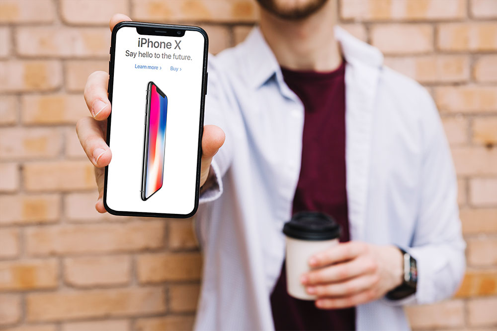 iphone x mockup in male hand