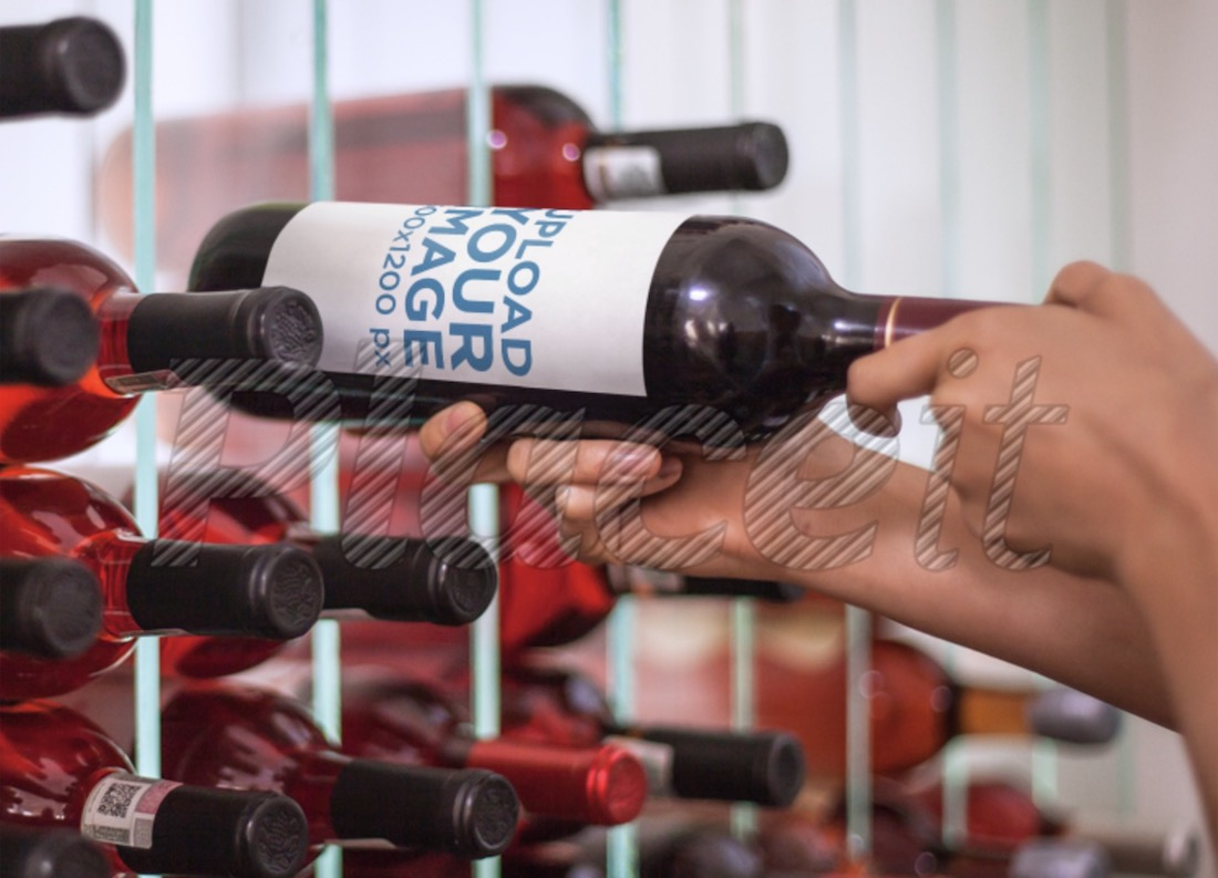 label mockup featuring a man taking a wine bottle from a wine cellar