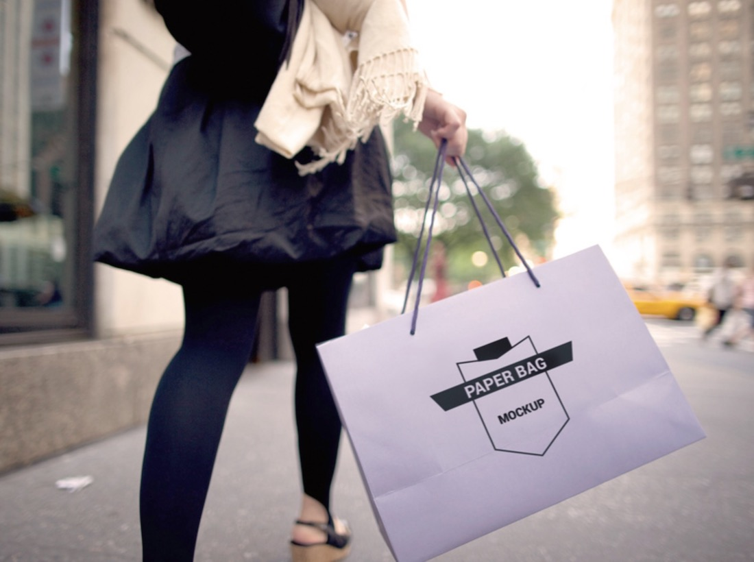 lady carrying paper bag mockup