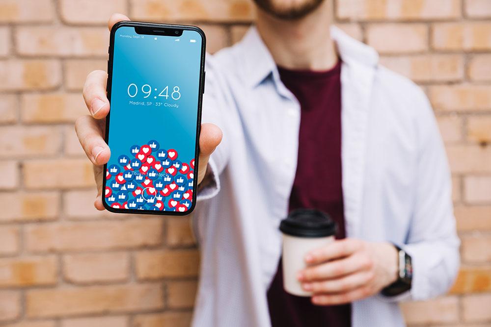 man holding iphone x mockup