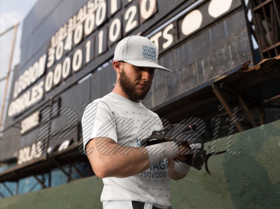 man wearing a baseball cap and a raglan t-shirt mockup