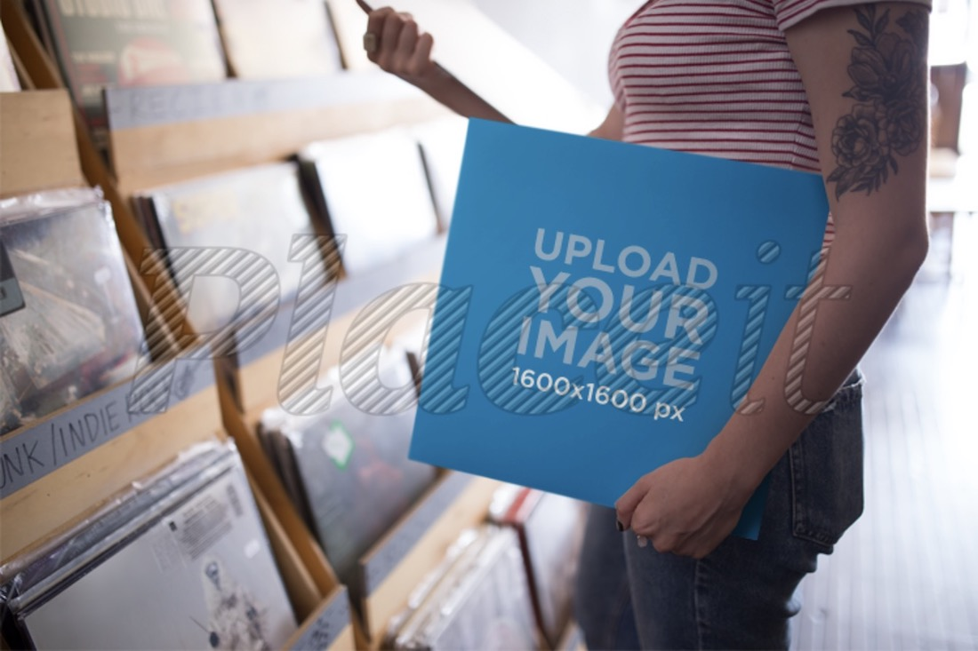 mockup featuring a woman holding a vinyl record
