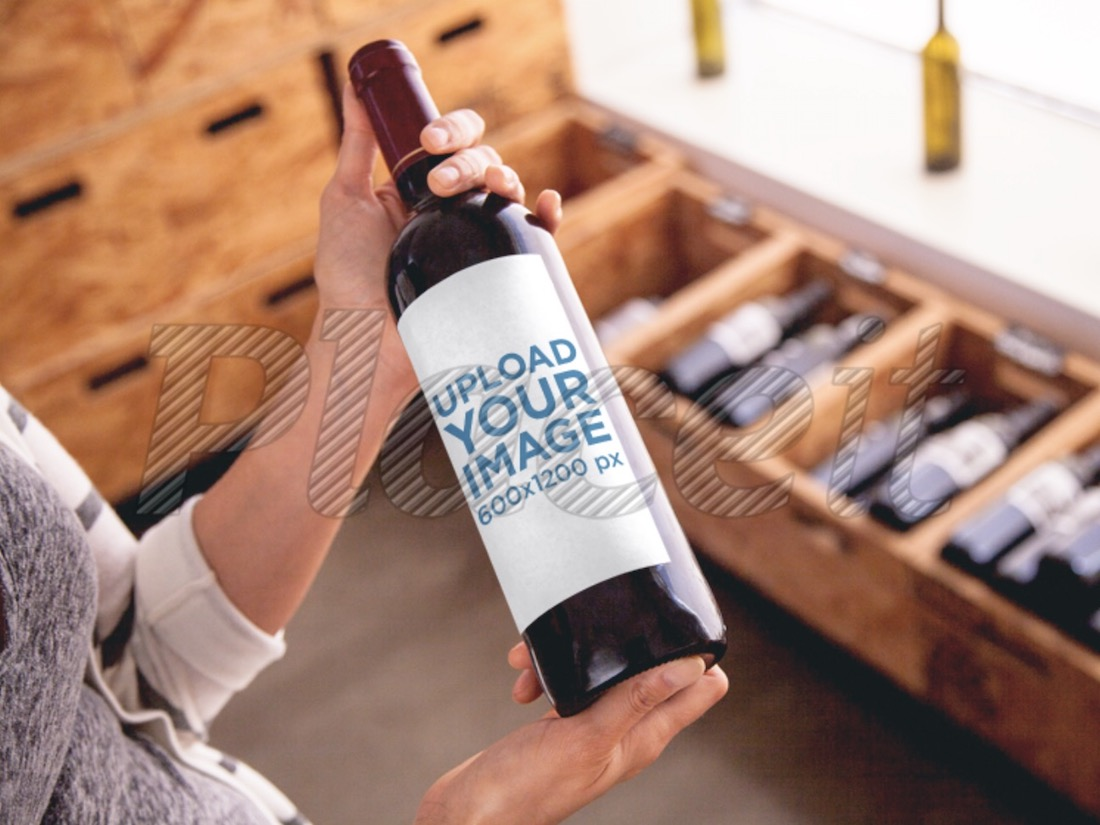 mockup featuring a woman holding a wine bottle