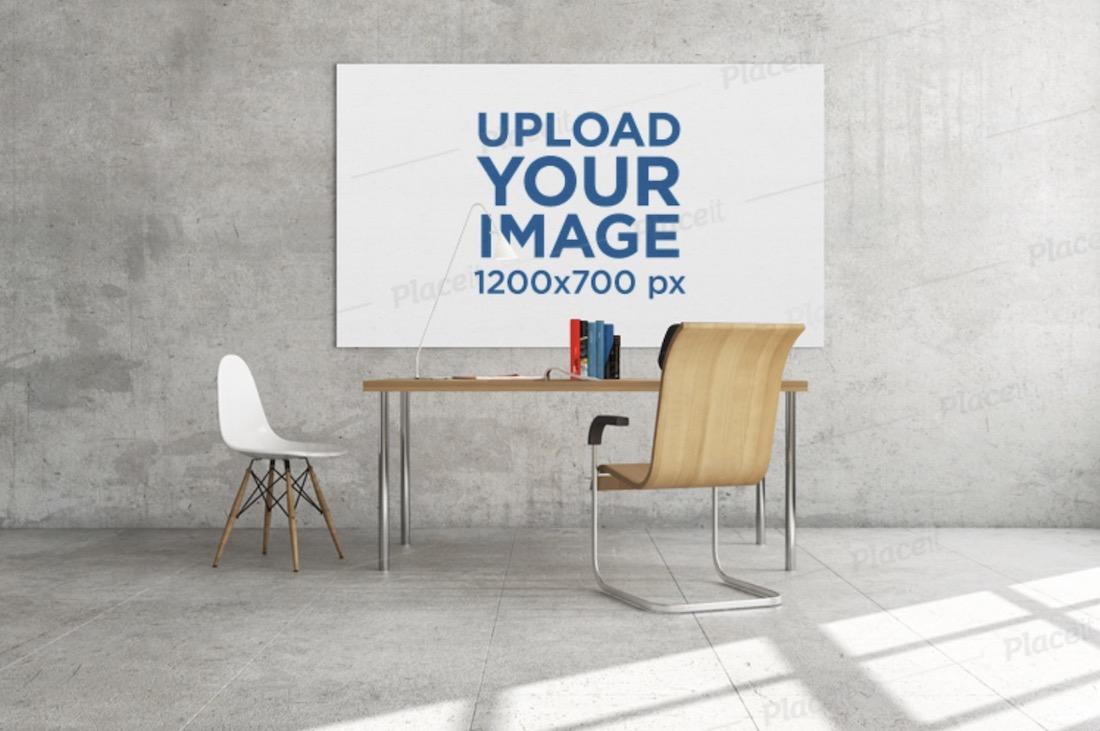 mockup featuring an art print hanging behind a work desk