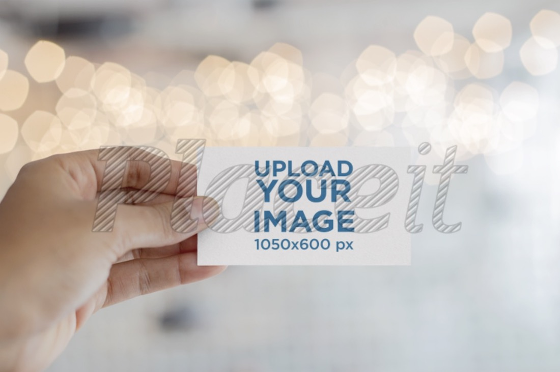 mockup of a business card in hand