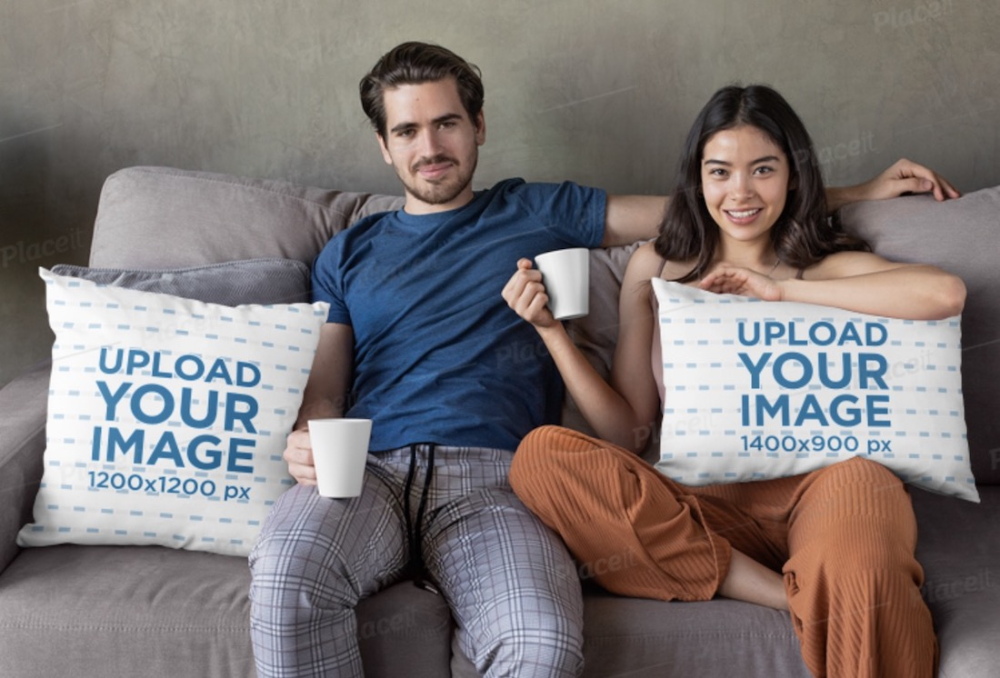 mockup of a couple having coffee on the couch with pillows