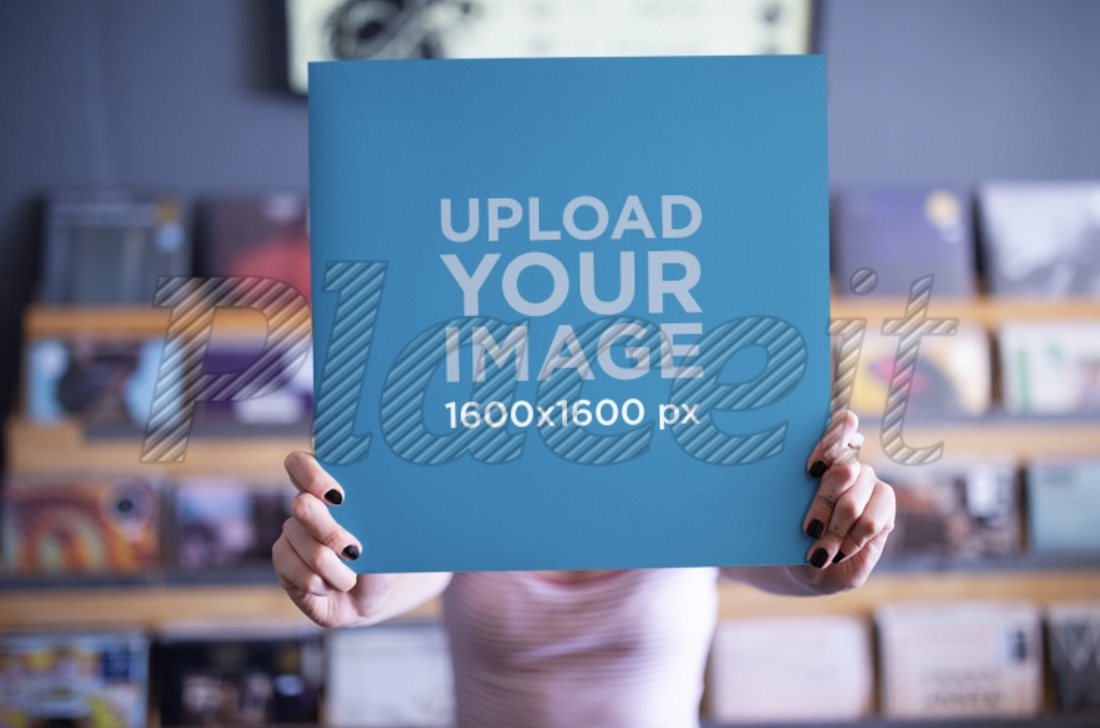 mockup of a girl holding a vinyl cover in front of her face