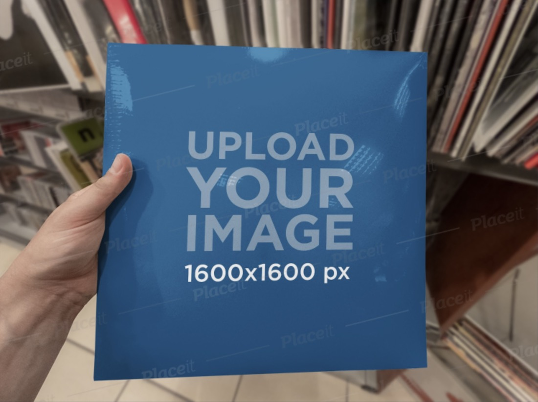 mockup of a man holding a vinyl cover at a music store