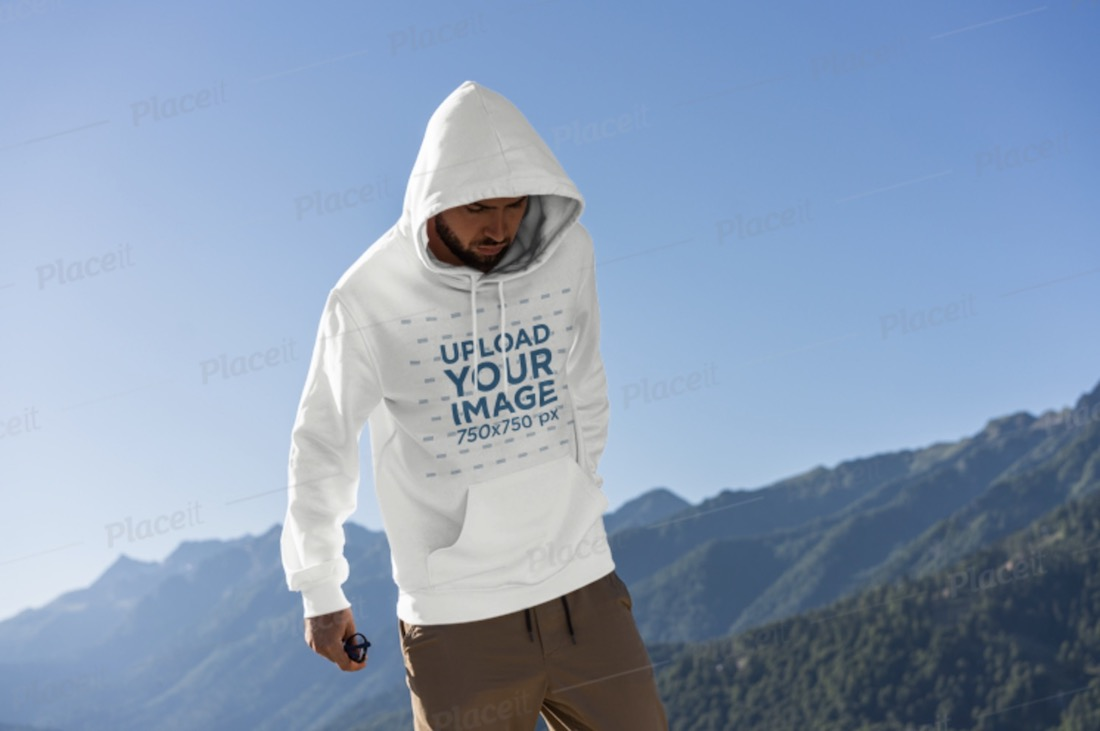 mockup of a man wearing a hoodie outdoors