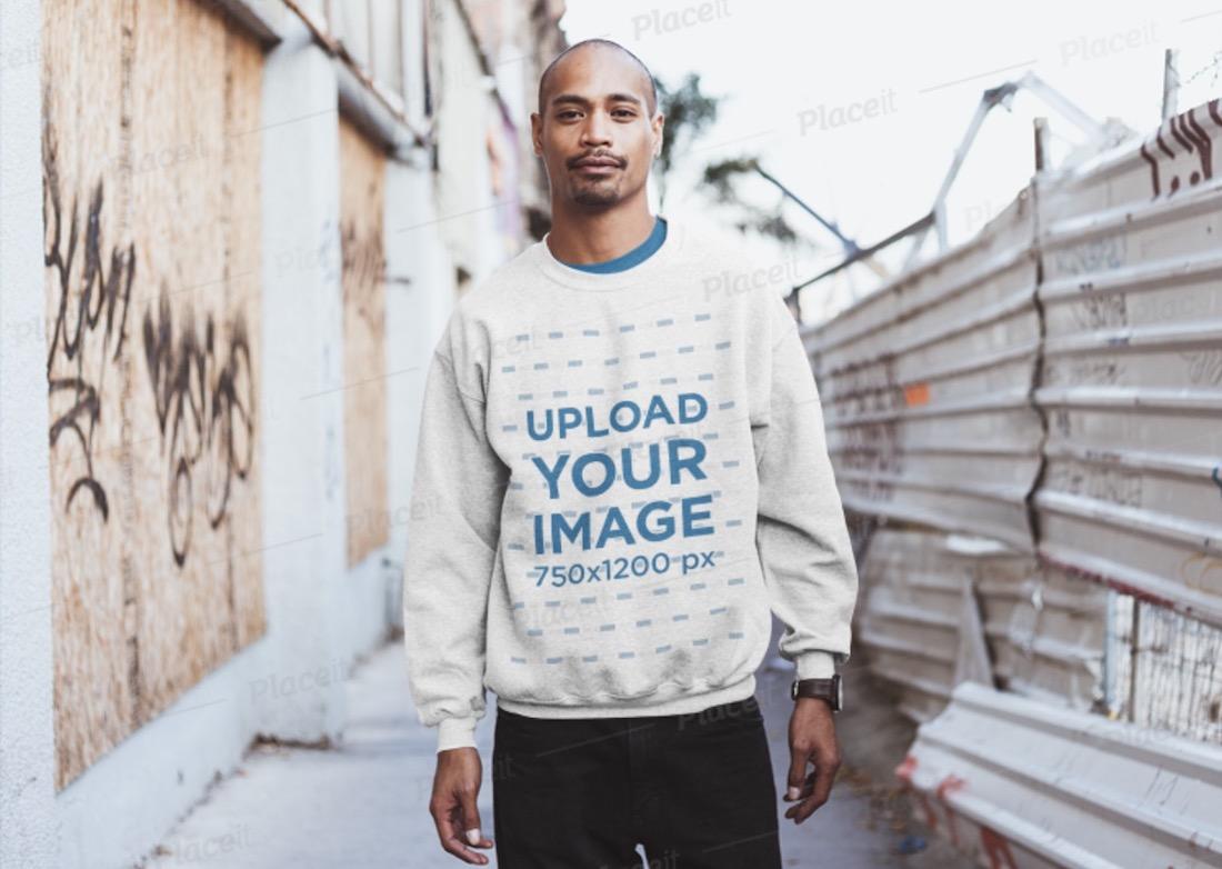 mockup of a man wearing a sweatshirt in an alley
