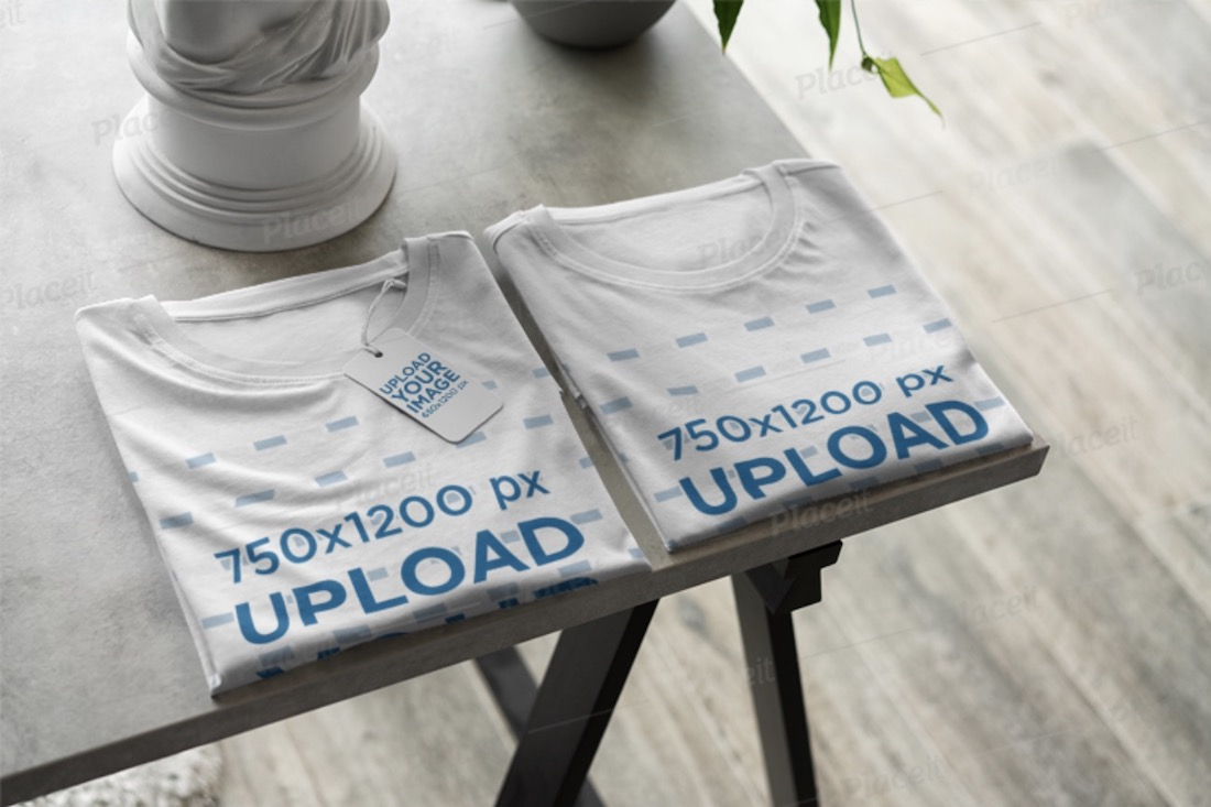 mockup of a pair of folded tees with a prize tag
