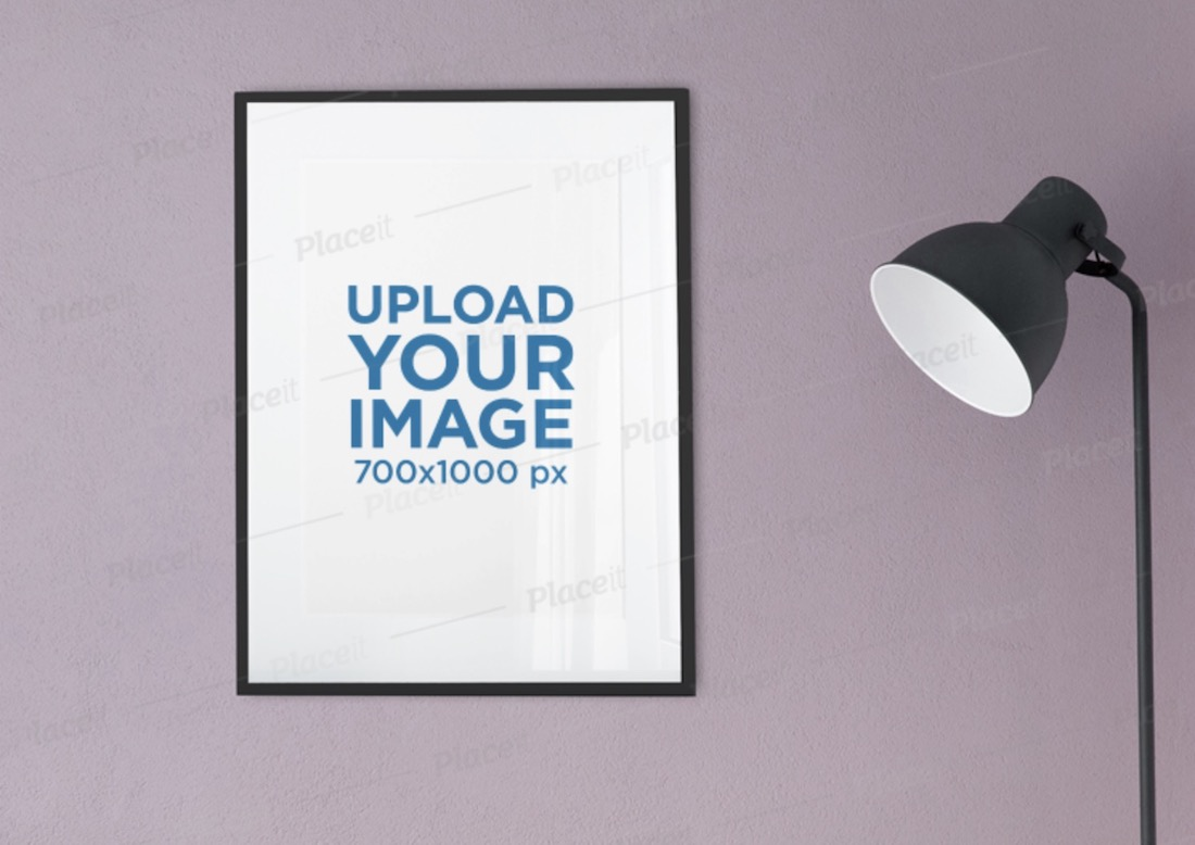mockup of a poster frame hanging next to a floor lamp