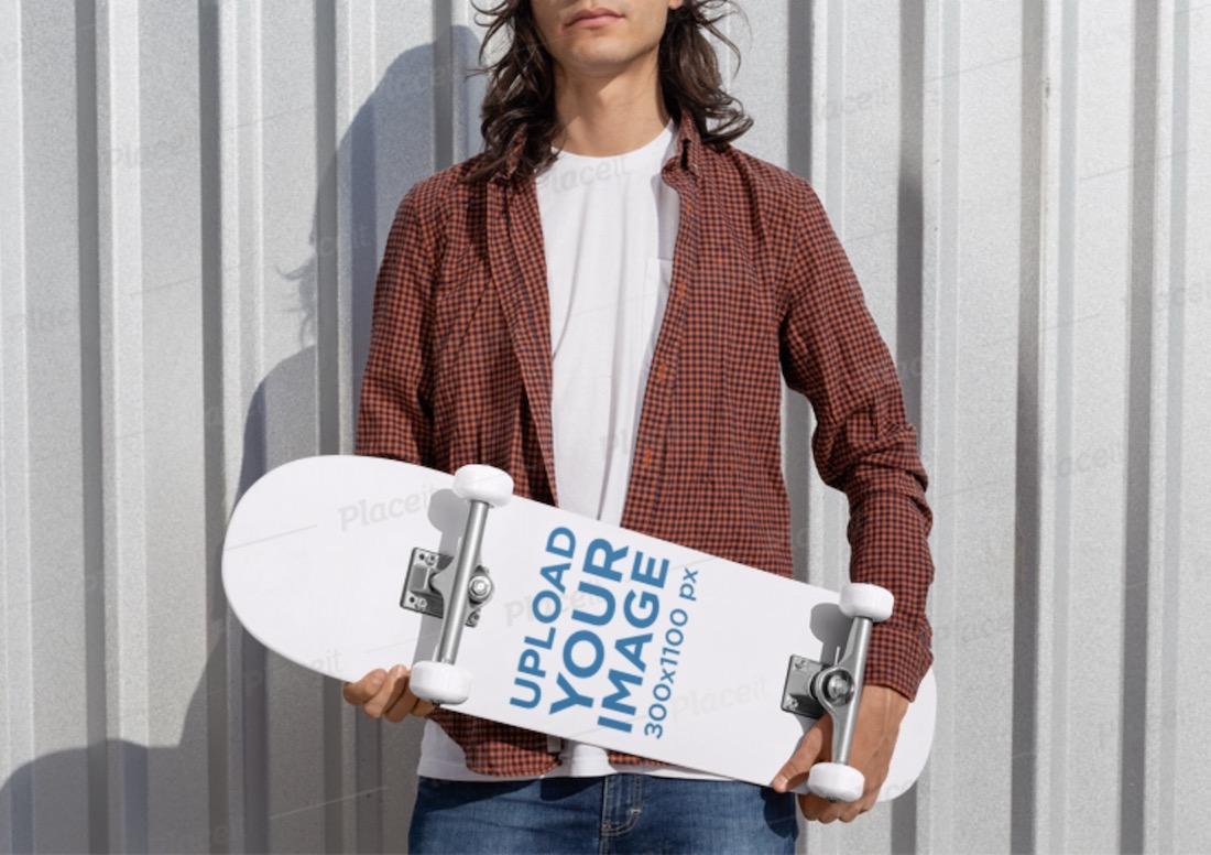 mockup of a rebel man holding a skateboard