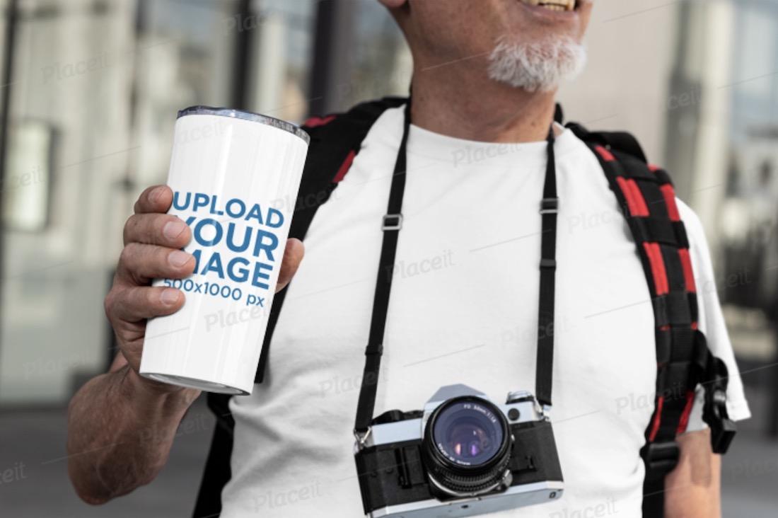 mockup of a senior man holding a 20 oz coffee mug