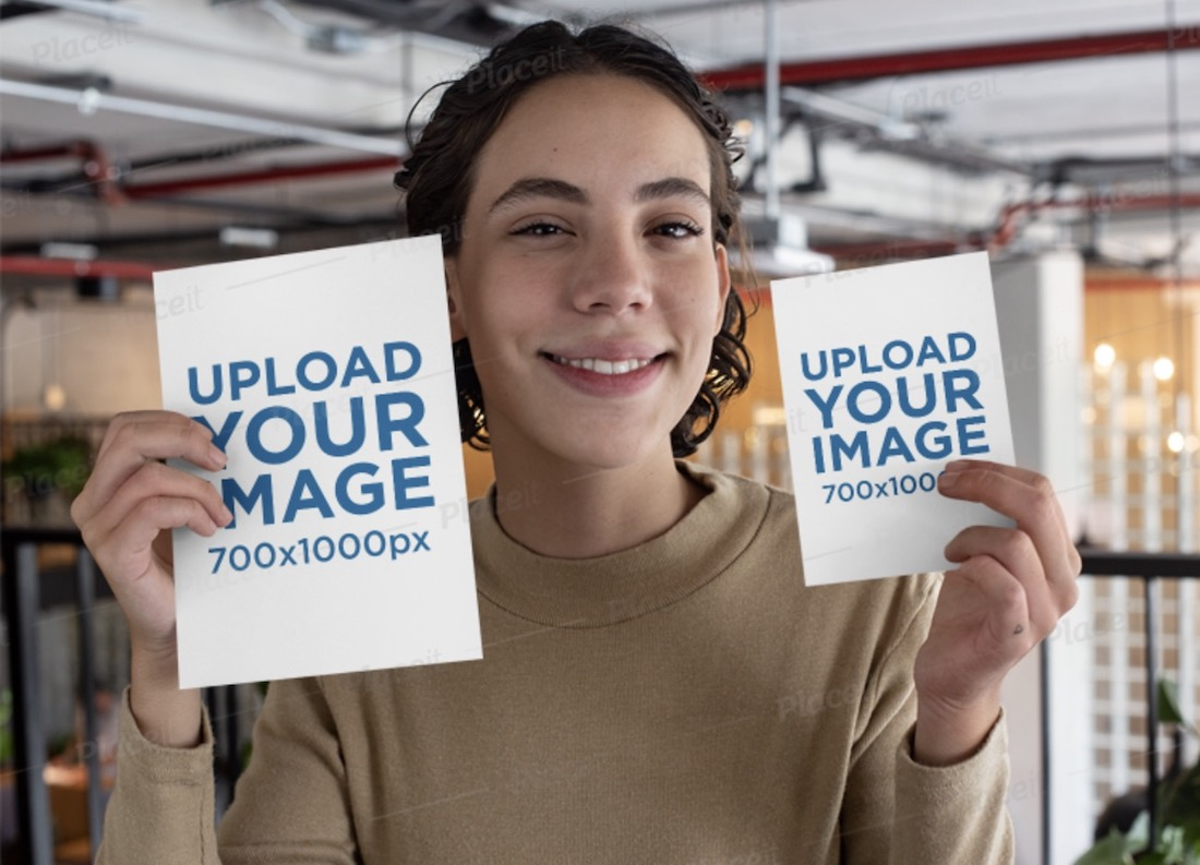mockup of a smiling woman holding two pamphlets