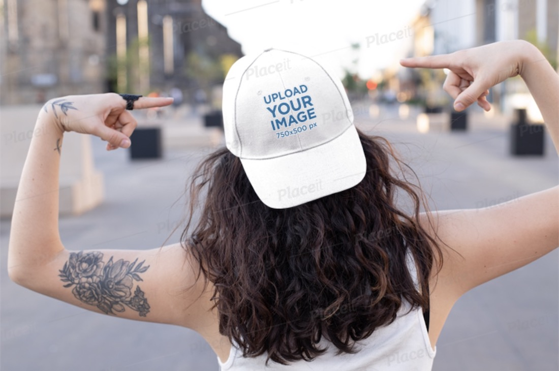 mockup of a tattooed woman pointing at her hat