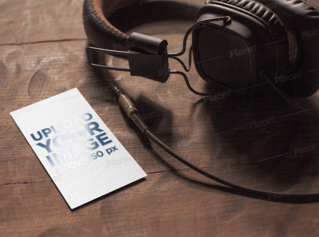 mockup of a varnish business card next to a pair of headphones
