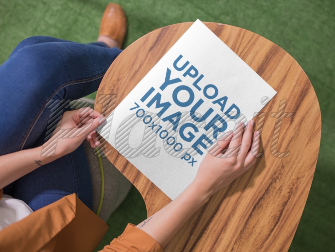 mockup of a woman about to open a brochure