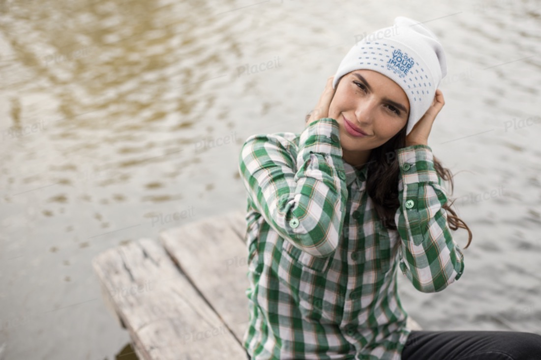 mockup of a woman adjusting her beanie
