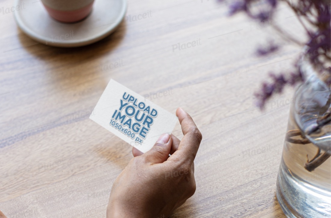 mockup of a woman holding a business card with embossed texture