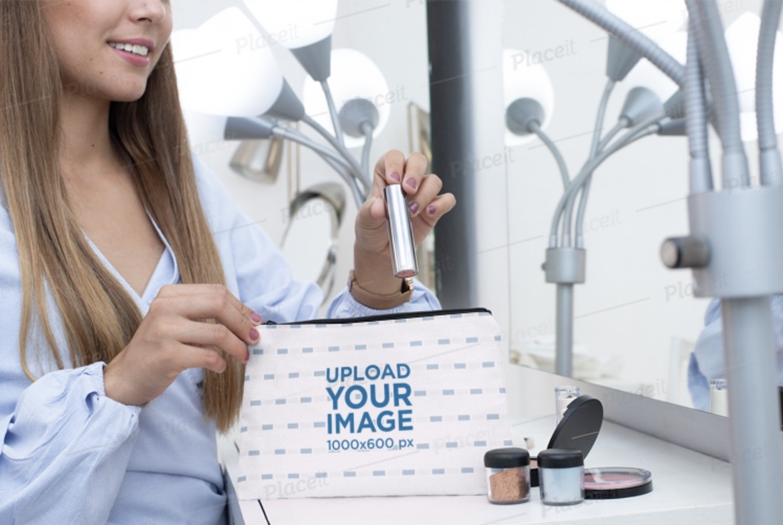 mockup of a woman putting her makeup in a pouch
